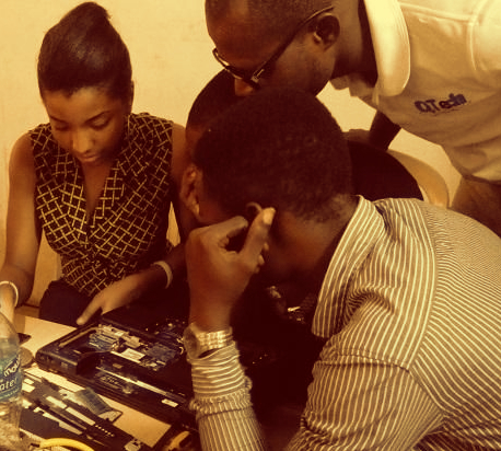 Young Nigerians learning to repair laptop