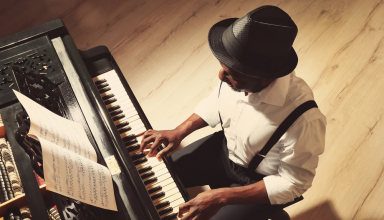 Artist playing piano for his latest music