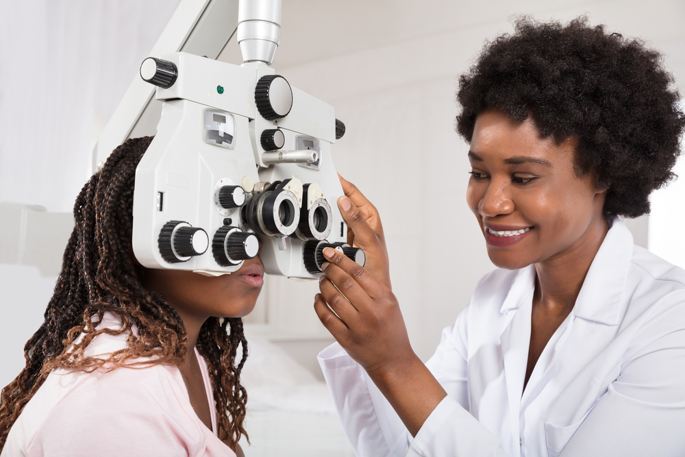 optometrist examining patient's eye in surulere